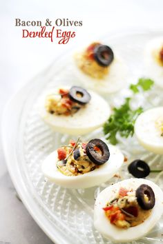 Bacon and Olives Deviled Eggs - The most delicious mixture of egg yolks, olives and bacon with sour cream, chives, and a sprinkle of cajun seasoning.
