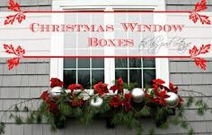 christmas window boxes Love the faux poinsettias and the silver .