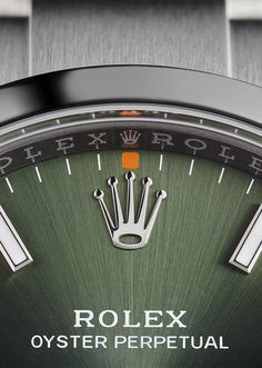 The olive green dial and eye-catching orange hour marker accents of a 34mm Oyster Perpetual, finished with the hand-set Rolex crown.