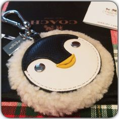 New Coach Penguin Keychain  So Cozy! And Soft. New with tags Coach Penguin Keychain. Comes with Black Coach Dust Bag and Coach Bag. Coach Accessories Key & Card Holders