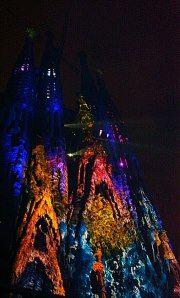 The amazing Sagrada Familia church of Barcelona, lit in multicolors, as part of the show for celebrating the Major Festival of La Mercè - september 2012