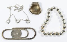 """Lot 531: Tiffany and Co Sterling Silver Jewelry Assortment; Four pieces including two pieces by Elsa Peretti designs including the """"Open Heart"""" necklace and the """"Thumbprint"""" money clip as well as a bead bracelet and a paper clip money clip; all marked"""