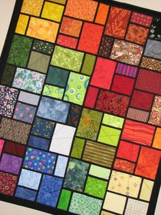 Stained Glass Quilted Wall Hanging by VillageQuilts on Etsy $68