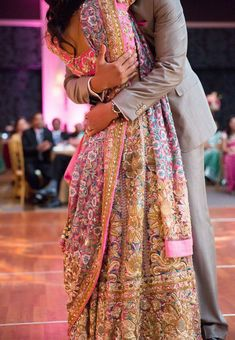 Gorgeous colourful lehenga and a tight embrace, Indian wedding,