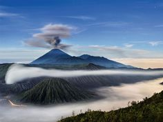 Mount Bromo (Indonesian: Gunung Bromo), is an active volcano and part of the Tengger massif, in East Java, Indonesia. Hawaii Volcanoes National Park, Volcano National Park, Bali Lombok, Volcano Wallpaper, Beautiful World, Beautiful Places, Volcano Photos, Places To Travel, Places To Visit