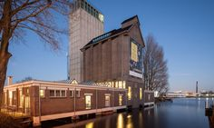 Wenink Holtkamp Architecten transformed a disused grain silo into a community food hub in Deventer.