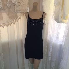 Little Black Dress Velvet material. Has rhinestones on the top. Very comfortable dress. Perfect for a nice dinner or a dance. Nothing wrong with it. 579 Dresses Mini