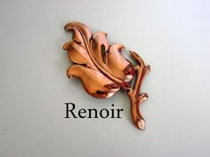 Check out this item in my Etsy shop https://www.etsy.com/listing/114295720/large-vintage-renoir-copper-leaf-brooch