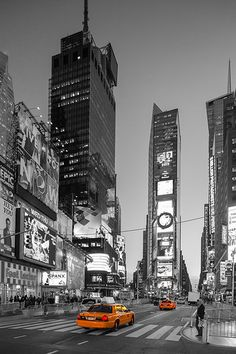 Times Square Picture...great with the selective coloring edit...making the taxis stand out in their signature yellow and therefore causing the rest of the monochromatic scene to look classic.