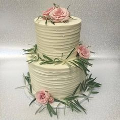 We love this rustic texture combined with the soft pale pink roses and olive leaves! #simple #rustic #texturedweddingcake #sweetlife