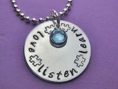 Autism awareness necklace.  Love, listen, learn with puzzle piece stamp.