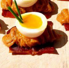 crisped serrano, winter squash purée & runny half quail's egg-topped canapé w/ chive
