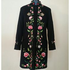 "Colorful, embroidered mandarin collared coat. Rich black cotton coat with beautiful floral embroidery. Mandarin collar, loop buttons. 97% cotton, 3% spandex.  Acetate lining.  Length is 33.5"" measured from collar.  15.5"" across the narrowest part of shoulder. 19"" from underarm to underarm. Victor Costa Occasion  Jackets & Coats"