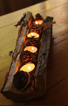 Take a piece of firewood, round out The middle, after cutting in half. Place on fireplace hearth after decorating with candles, pine cones and more