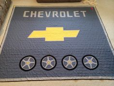The finished Chevrolet quilt that I made for our bed!