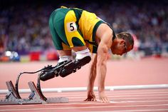 "On the blocks ""Blade Runner"" Oscar Pistorius of South Africa gets ready to compete in the men's 400-meter semifinals Sunday at the Olympic Stadium in London. Pistorius, who advanced to the semifinals in qualifying Saturday, was not able to reach the final."