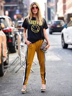 Go beyond wearing a T-shirt with just jeans and shorts. Here are 22 fresh ways to wear a T-shirt that are so 2017.