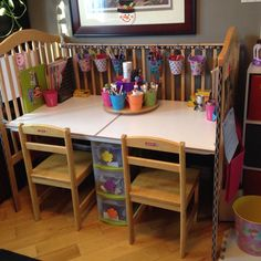We upcycled our old drop-side crib into an art desk, along with a homemade carousel for markers and such!