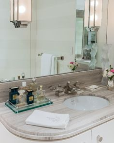 Bright perfume tray in Bathroom Transitional with Athens Silver Cream next to Light Gray Countertop alongside Grey And White Marble and Art Deco Bathrooms
