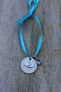 Something old, something new, something borrowed, something blue, and a sixpence in her shoe. This listing includes a silver sixpence, blue Swarovski crystal, and a stamped stainless steel heart charm. All hang on a silk blue ribbon. Please let me know Im notes to seller when you place your order what letter you would like stamped on the heart.    ♥Please feel free to contact me if you have any questions or I can help in anyway. All of my pieces are made to order and can be completely…