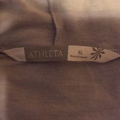 Athleta top Brand new condition! Little wrinkly from being folded. I am a normal size small this is an XL but it's meant to fit baggy so it can be a one size fits all. Very light and comfy! Cute for a throw over to yoga or the gym! lululemon athletica Tops Sweatshirts & Hoodies