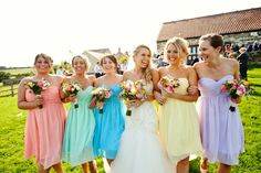 I absolutely LOVE the rainbow bridesmaid dress idea!!!  Image by Richard Skins