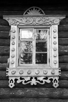 Cabin Window.  Wow, what an ornate window for a log home.