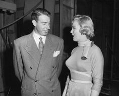 """Joe DiMaggio visits Marilyn on the set of """"Monkey Business"""", 1952."""