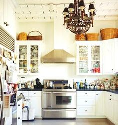 large baskets on top of kitchen cabinets