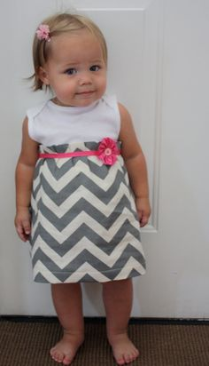 How cute is this!?! Looks like an easy sewing project and could leave onesie intact to act as bloomers. Cutie Patooti!
