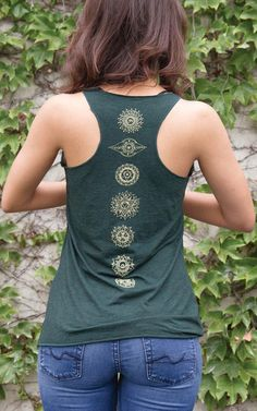 In ancient Indian mythology, and even today, chakras are considered to be the most important energy spots in the body. Celebrate the 7 chakras with this must-have tank! Printed down the spine with sophisticated metallic ink, the chakras are represented by unique hand-drawn symbols.
