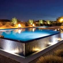 To heighten visual impact, landscape architect designed and built this pool/spa to be elevated two feet above ground, which allowed for the creation of an expansive spillway.