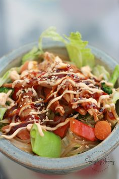 These Korean noodles bowls are one of my family's favorites! Chicken made in the crockpot layered with stir-fried noodles, lettuce and sauces. (This post contains affiliate links. Asian Recipes, Healthy Recipes, Ethnic Recipes, Asian Foods, Healthy Food, Pork Hock, Bulgogi Recipe, South Korean Food, Korean Chicken