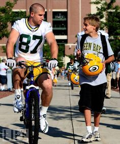 one of the COOLEST things about Green Bay, yes the players ride kids bikes to and from practice across the street