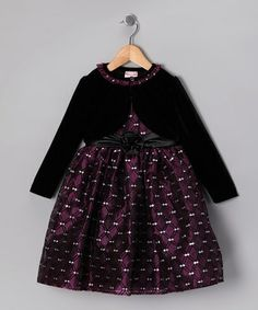 Any little lady can dress up easily in this fancy frock thanks to a hidden back zipper and ribbon tie. With plenty of pouf, shimmery sparkle and a coordinating bolero, it's sure to impress any classy crowd.