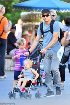 Daddy dearest: Jeremy Renner was every inch the proud father as he enjoyed some personal time with his daughter Ava at Disneyland on Wednesday