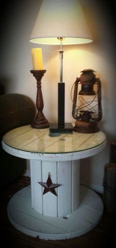 Rustic shabby chic end table made from old wooden electrical wire spool by Megan Kleinhardt