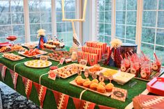 Fun superbowl party dessert table with AstroTurf. See full party here: http://www.prettymyparty.com/superbowl-party-dessert-table/