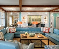 Oak beams were left unpainted in the family room where Mullin Segerson chose accessories with nautical references. Outdoor Living Rooms, Coastal Living Rooms, Living Room Decor, Living Spaces, Living Area, U Shaped Couch, Shingle Style Homes, House Of Turquoise, Turquoise Sofa