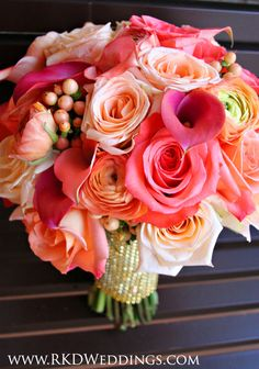 """Stunning shades of ALL coral in this bouquet! Movie Star roses, Tiffany roses, Donna roses, coral/peach ranunculus, coral hypericum berries and coral """"Passion Fruit"""" calla lilies."""