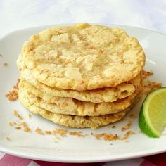 Coconut Lime Chewy Sugar Cookies - a great chewy sugar cookie with the unexpected zing of lime along with scrumptious toasted coconut. Makes a terrific mid-week treat for lunchboxes and after school snacks.  Get over 150 of our tried tested, baked and photographed cookies on our Pinterest cookie board. http://pinterest.com/RockRecipes/the-cookie-board-by-rock-recipes/