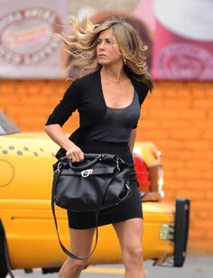 Jennifer Aniston~ this woman can make any outfit look amazing!  Simple yet sexy!