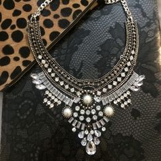 Vintage Silver Statement Necklace New festival style chain and crystal rhinestone bib necklace. Silver alloy with faux pearl details.  High quality piece can be dressed up and down. Sorry, no trades. Jewelry Necklaces