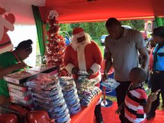 Usain Bolt Hosts Christmas Treat For Children