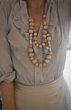 Embellish polished work looks with a fabulous statement necklace