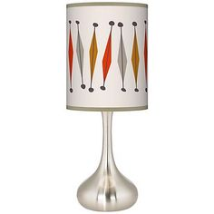 Overflowing with mid century modern style, the Tremble giclee print shade on this table lamp lends vintage inspired elegance.
