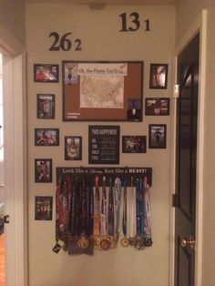 Running wall display. Medal display. Marathon. Showing pictures from all my race milestones such as 1st half marathon and displaying all PR's the map is of all the places I've ran plan to hit all 50 states. 26.2 13.1