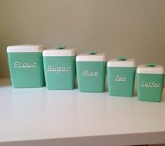 Nally Ware canisters. Similar or same set is used on Call the Midwife