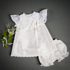 Jessa Silk Dress & Bloomers • 100% single layer silk dupioni in white • White lace and trim • Embroidered white netting • Functional silk covered buttons • Silk ribbons • Handmade in the USA • Includes - Christening Dress & Bloomers Sizing 3-6 months: Chest up to 19 inches, Height