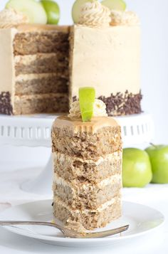 Apple Cake with Peanut Butter Frosting - This apple cake recipe is perfect for fall! Moist apple cake layered with peanut butter frosting and chocolate jimmies, garnished with fresh apple slices. Apple Cake Recipes, Delicious Cake Recipes, Yummy Treats, Sweet Treats, Dessert Recipes, Apple And Peanut Butter, Peanut Butter Frosting, Peanut Butter Recipes, Moist Apple Cake